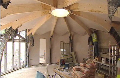 The main decagon living area nears completion as the walls are plastered.