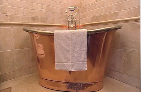 The stylish gold free standing bath tub.