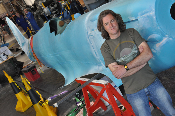James May stands proudly beside his Airfix replica.