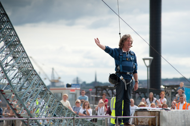 James May stands on top of a giant Meccano construction.
