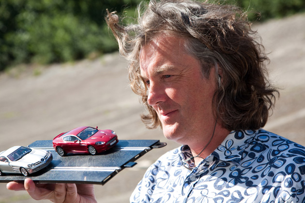 James May holds up some Scalextric model cars.