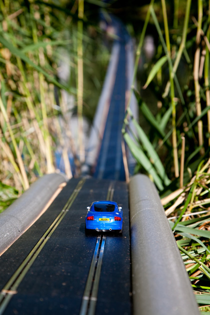 A Scalextric model car on the road.