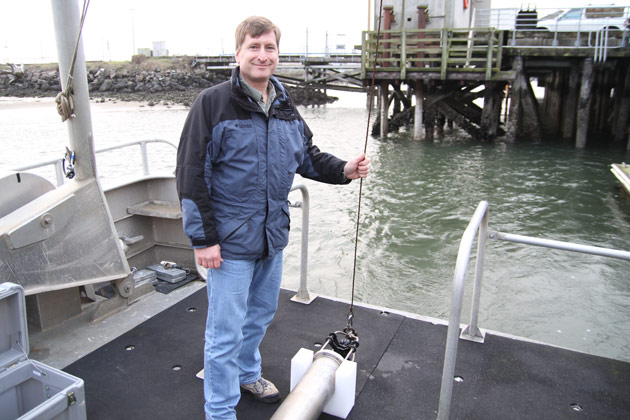 Joseph Hazel (left) and Robert Dziak (right) carry the hydrophone.