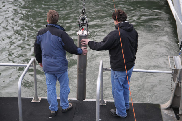 Robert Dziak (left) and Joseph Hazel (right) lower the Hydrophone.