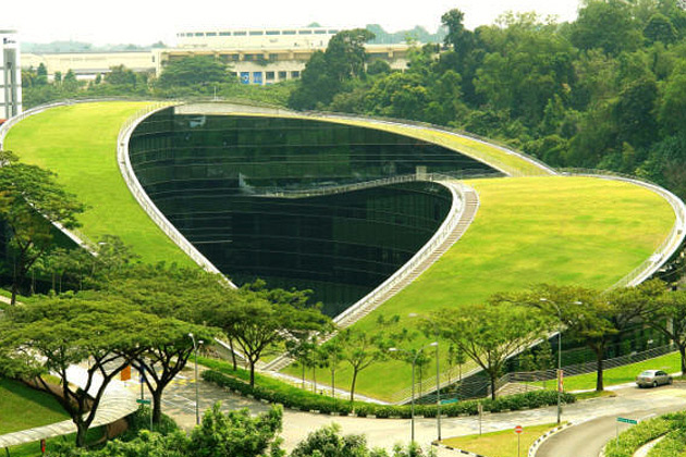 "The ecologically friendly ""green roof"" housing The Nanyang Technological University's School of Art, Design and Media."