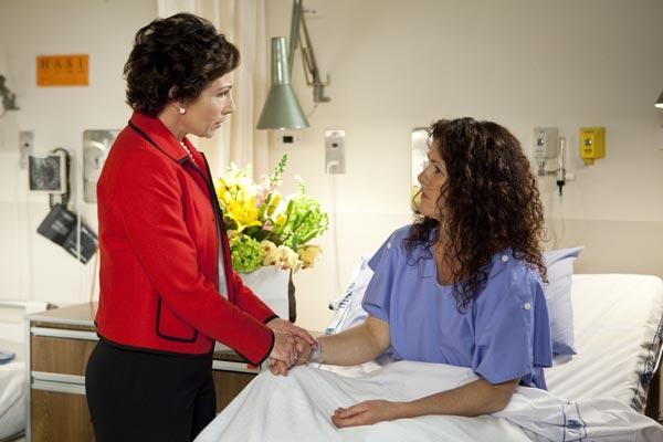 Agnetha checks on Ingrid in hospital