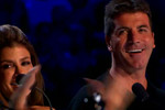 Simon smiles after a performance on The X Factor USA.