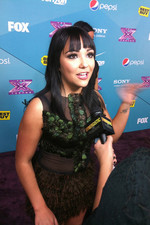 Jennel Garcio talks to press at the X Factor Top 12 party