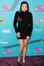 Khloe Kardashian arrives at the X Factor Top 12 party in Hollywood.