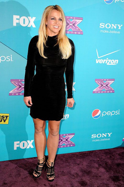 Britney Spears walks the press line at the X Factor Top 12 party in Hollywood.