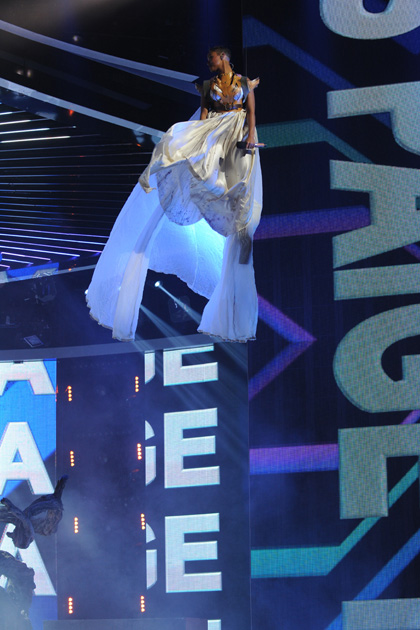 "Paige Thomas flew in from the ceiling for her performance of Berlin's ""Take My Breathe Away"" from Top Gun."