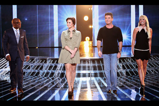 L.A. Reid, Demi Lovato, Simon Cowell, and Britney Spears take the stage.