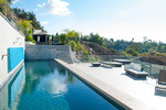 Dive in! The Top 16 acts moved into this modern mansion atop the Hollywood Hills just before the Live Shows. Check out their swanky place!