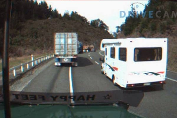Campervan vs trucks on a blind bend