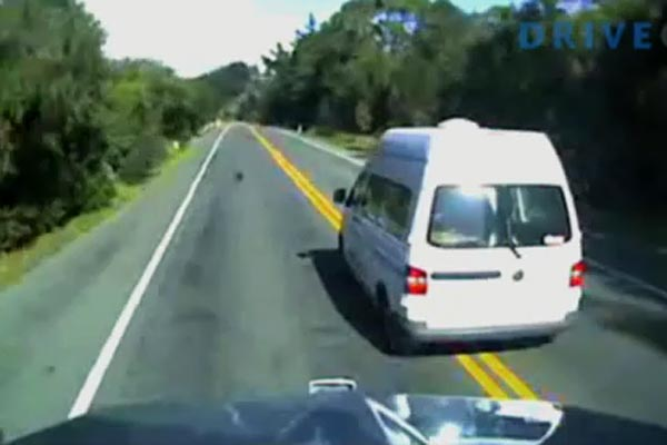 An indecisive campervan driver nearly gets a truck up the rear