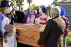 Cam attends the funeral of his clown mentor.