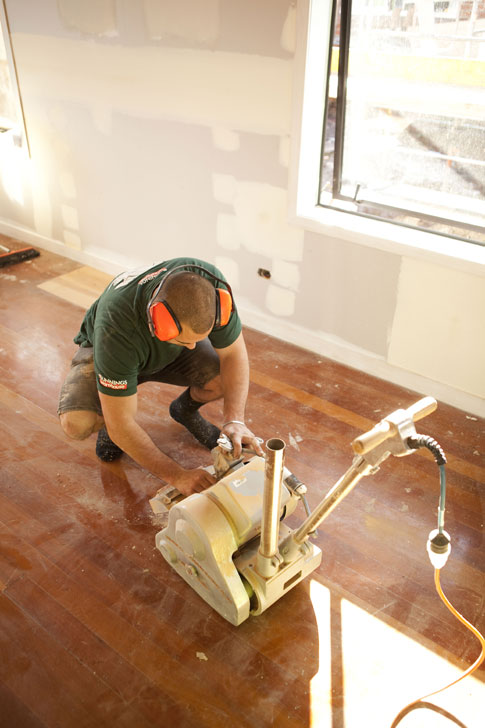Rhys sanding the floors