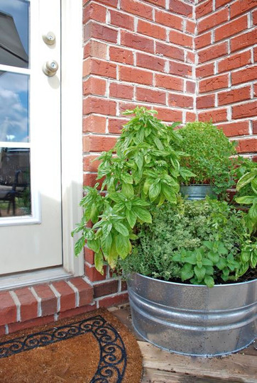 This patio garden is made from a couple of galvanized tubs stacked together.