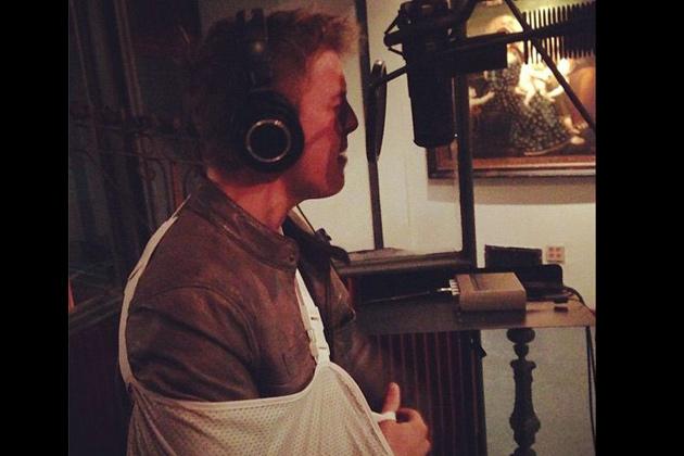Drew in the studio, nursing a torn rotator cuff.