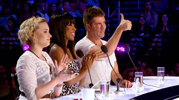 Simon Cowell likes what he sees at X FACTOR auditions.