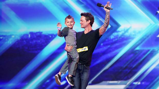 Jeff Gutt and his son wave to the crowd.
