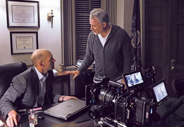 David Fincher (center) with Corey Stoll, directed two episodes of Netflix's House of Cards including the pilot.