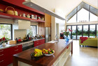 This kitchen uses red accents