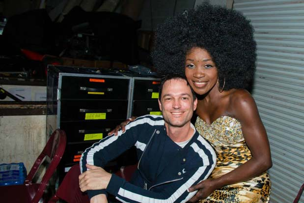 Jeff Gutt and Lillie McCloud snuggle up for a photo next to some equipment backstage at the Shrine Auditorium.
