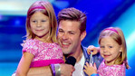 After his James' success his adorable daughters joined him onstage.