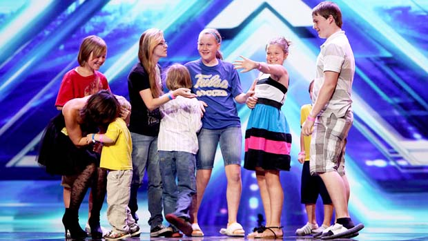 Victoria's eight children rushed the stage after she got four yeses from the judges.