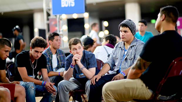 A group of the boys appear solemn as they wait to hear if they made it into the final 10.