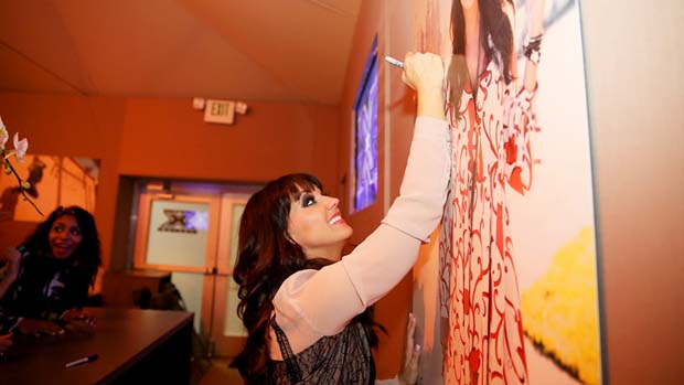 Rachel signs her X Factor portrait before saying her final goodbyes