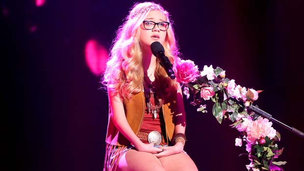 "Rion was dressed like a flower child as she gave a quiet and emotional performance of Elton John's ""Your Song."""