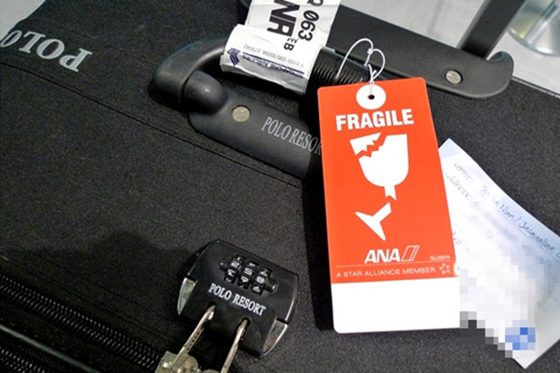 Pop a FRAGILE tag on your bag.  This will help ensure that your luggage sits on top of the heap and comes out of the baggage claim first.