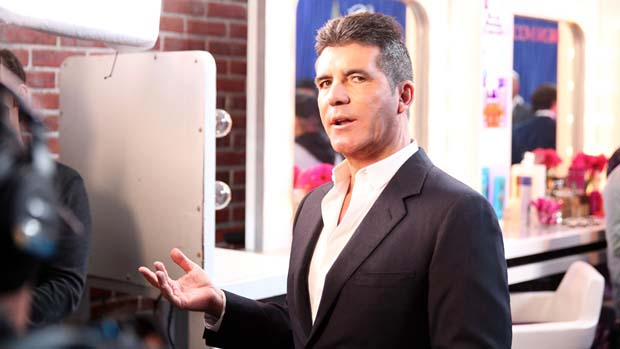 Simon Cowell gets animated after the show.