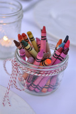 Use a paper table runner and pop jars of crayons on the table.  This is a great way to keep kids entertained or you can have guests write messages on the night.