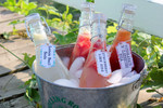 Make your own healthy sodas by adding juice and shopped fruit to soda water or lemonade.  Present in vintage glass bottles with handmade paper tags.