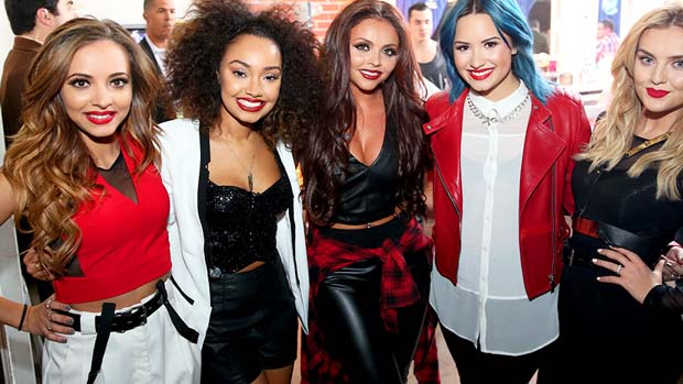 Demi Lovato poses backstage with the hit band, Little Mix!