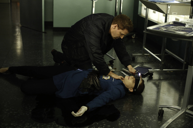 Booth finds Brennan on the floor in a pool of her own blood
