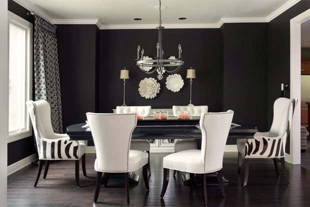 There is no doubt you're making a statement with a black dining room – use it to make the dining chairs pop.