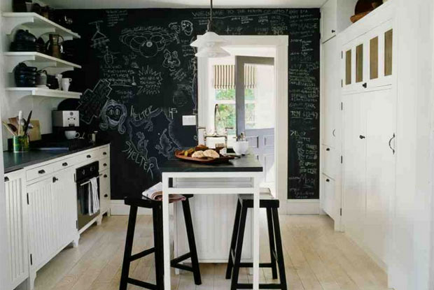 Use a black wall in the kitchen for notes and doodles. Let the kids exert their will to draw on the walls!