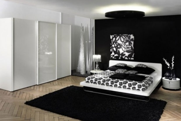 The black and white walls allow the resident to add any coloured cushions and duvet to completely change up the mood as they fit.