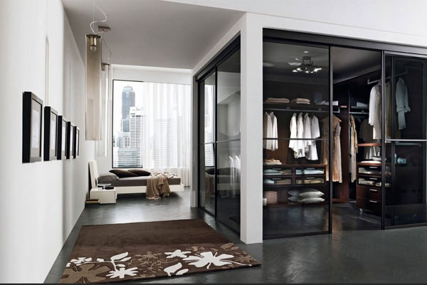 Glass doors keep this wardrobe sectioned off yet still accessible
