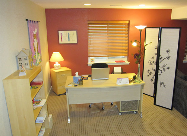 In all your rooms, set it so that the workspace allows you to face the door for most of the time. i.e. in a study set your desk side on or facing the door so you don't have your back to the door.