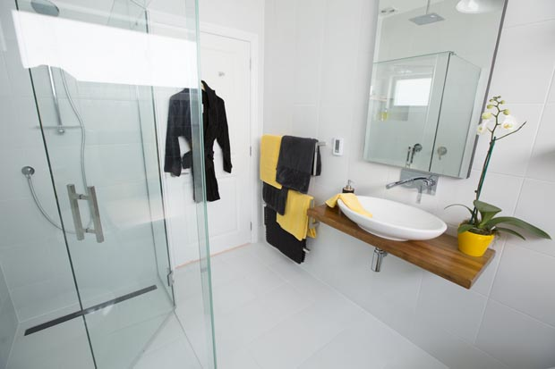 Loz and Tom's bathroom was hit with the judges for its mirror cupboard and decor