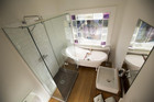 Alisa and Koan's traditional-style villa bathroom with their restored window
