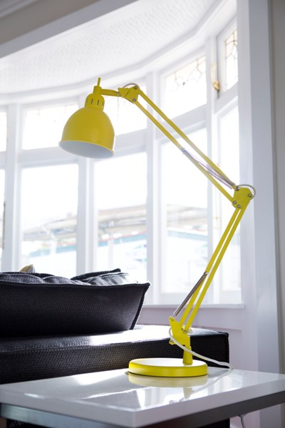The lamp adds an accent of yellow