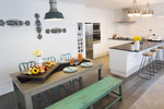 Alice and Caleb's industrial kitchen and dining space