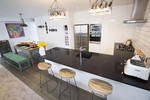 A breakfast bar offers extra dining space