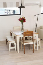 The dining table is made from recycled timber from the Christchurch rebuild